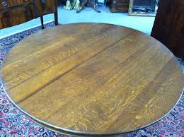 offered here is a gorgeous antique oak round pedestal dining table circa 19th century this piece is in excellent condition it features beautifully carve
