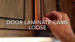 How To Reglue Laminate On Cabinet Door Youtube