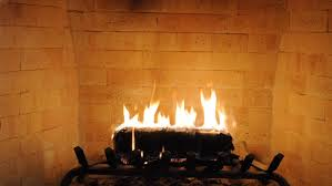 brick fireplace closeup with log burning
