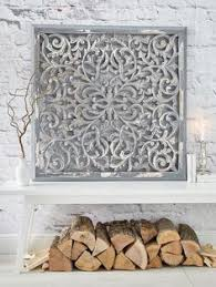 this dramatic wall panel finished in antique white is very heavy very detailed and dare we say very very pretty the intricate filigree design is  on antique white wood wall art with this dramatic wall panel finished in antique white is very heavy