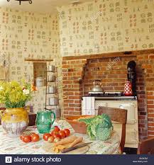 Country Kitchen Wallpaper vegetables on table in country kitchen with cream aga oven and 4890 by uwakikaiketsu.us