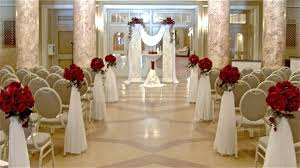 indoor wedding arches. two pillar altar set and aisle stands with drop draperent matching centerpieces indoor wedding arches