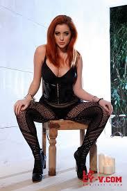 Kinky busty redhead in corset