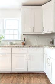white kitchen cabinets antique cream colored