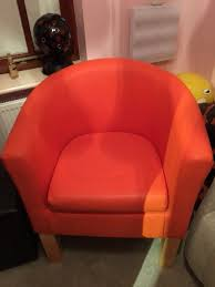 bright orange faux leather tub chair in excellent condition hardly used and no marks