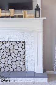 white airstone and concrete faux fireplace tutorial blesser house featured on remodelaholic