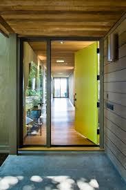 neon metal and glass front doors