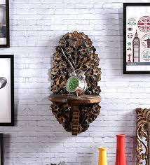 solid wood hand made decorative wall shelf in brown finish by shilpi