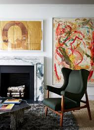 Interior design by Rob Stilin. Abstract painting by Dan Colen. The letter Q  is