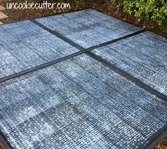 how to paint a faux concrete rug onto your ourdoor patio uncookiecutter com