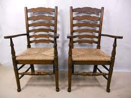 oak ladderback carver armchairs with rush seats sold pair oak ladderback carver armchairs with rush seats sold