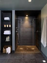 dark-colored basement walk-in shower and glass shelves on the side