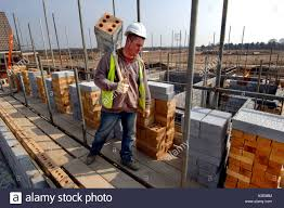 a young hod carrier worker on a building site a load of a young hod carrier worker on a building site a load of bricks