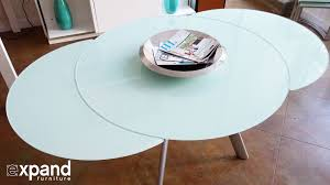 erfly round glass extending table demonstration