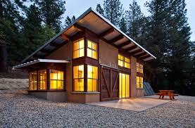 The term Straw bale might conjure up a fairly primitive house  but    The term Straw bale might conjure up a fairly primitive house  but the straw is all in the walls  With large windows  and metal roof  this straw ba