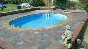 classic retaining wall ideas around a pool