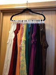 use shower curtain rings and put them on a hanger to use as a way to hang all of your tank tops on one hanger would work for scarves