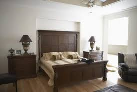 grey walls with brown furniture. brown wood furniture and gray walls create a soothing balance of cool warm tones grey with i