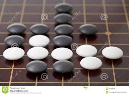 Game With Stones And Wooden Board Go Game Playing By Stones On Wood Board Stock Photo Image of 4