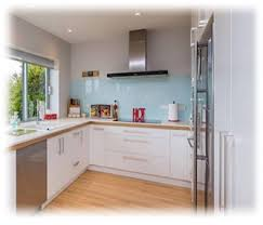 A Reflections splashback installed in a modern kitchen showcasing the  colour 'Cascade Metallic'.