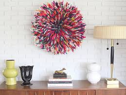 juju hat is a beautifully natural wall decoration the juju hat folds up into itself to be very portable when moving or storing