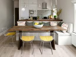 bench style kitchen tables chairs long wooden table pillows window contemporary style hanging lamps