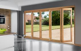 bi fold glass exterior doors with wooden frame for large kitchen with white and gray wall interior color decor ideas