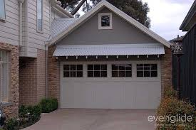 house with a timber tilt garage door herie style