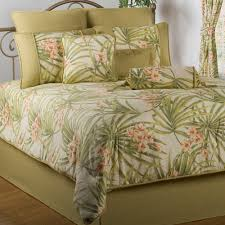 interior white tropical bedding sets with green leaves pattern plus green pillows above green bed