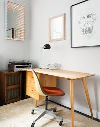 mid century modern home office. midcentury modern home office is decorated with unique lighted mirror mid century