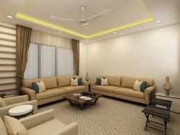 cream color sofa with color cushions and false ceiling