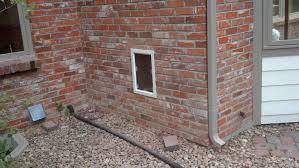 pet door gallery doors in brick walls