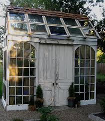i love the arched windows and old doors used in this greenhouse by dreyne