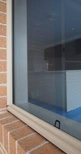 standard fibreglass mesh fly screen on an awning window standard sliding barrier door with diamond