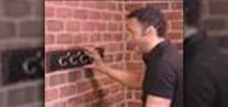 how to hang a coat rack on a brick wall