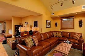 italian furniture small spaces. Italian Living Room Ideas Using Brown Leather Sectional Sofa For Small Space And Plaid Printed Toss Pillows With Yellow Wall Color Furniture Spaces N