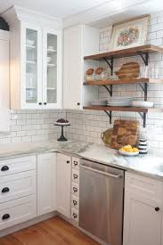 White Shaker Cabinets With White Subway Tile Back Splash With Darker