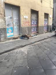 photo essay italia   this photo from naples shows a homeless man sleeping on the side of the street