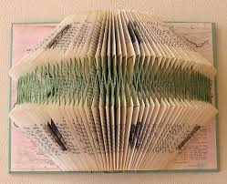 decorating with books in unusual ways was one of those ideas their book folding project was inspired by the art of mary bennett