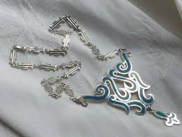 vintage taxco sterling silver necklace with large pendant inlaid with turquoise mexico