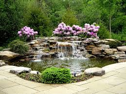 Traditional Landscape/Yard with exterior stone floors, Pond, Stacked stone  waterfall, Waterfall, Water feature
