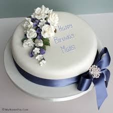 The Name Mansi Is Generated On Elegant Happy Birthday Cake With
