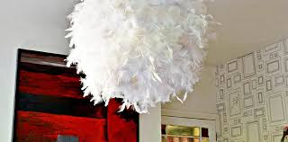 a simple affordable and beautiful diy feather lampshade