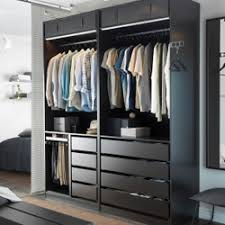 ikea pax wardrobe lighting. A Modern Bedroom With An Open Black-brown PAX Wardrobe Combination, STRIBERG Lighting And Black STAVE Mirror Ikea Pax