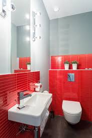 make a big statement with red in this tiny bathroom red pops against the dark floor white fixtures and gray painted walls if you attempt this in your