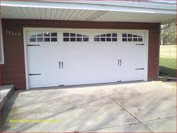 four sets of symmetrical iron strap hinges on tongue and groove bead board give the illusion 15 best fancy garage doors