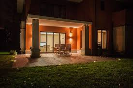 travertine house illuminated patio with garden