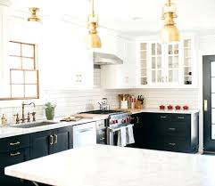 black cabinets white countertops black and white cabinets with white marble and brass fixtures kitchen flooring white cabinets dark countertops