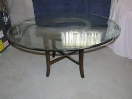 halo ebony dining table with 60 inch round glass top from crate barrel