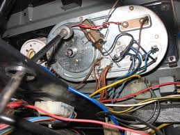 76 fi bus fuel gauge suddenly wonky itinerant air cooled see the black and brown thing the red and black wires coming off of it that s the vibrator notice on the left side there is a fork shaped piece of